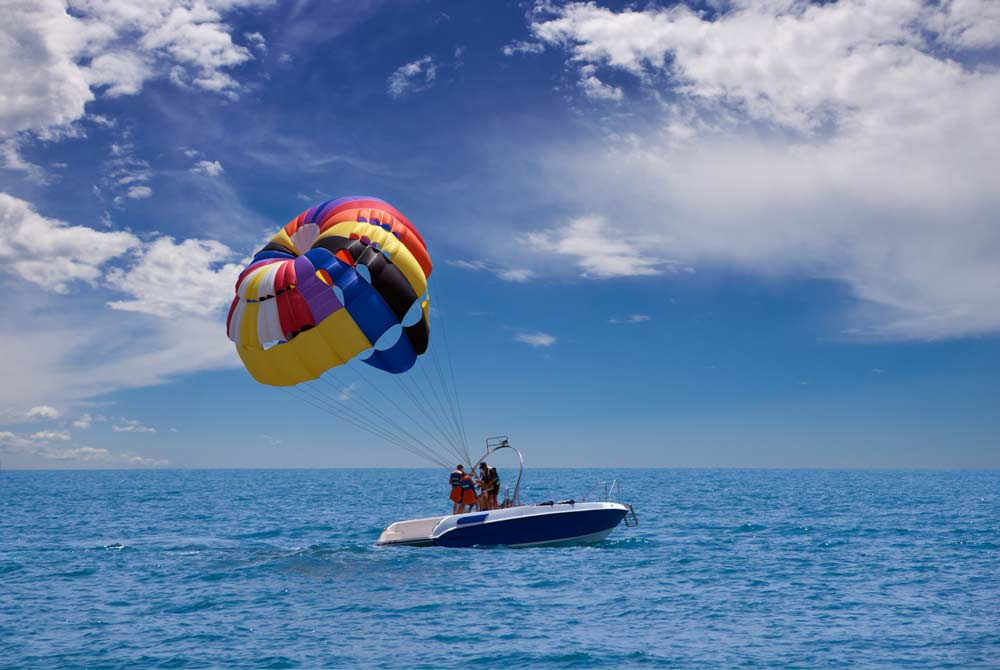 Parasailing In Miamisailing Charters Miami Fort Lauderdale Private Skydiving Over A Beach Florida