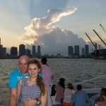 A couple on the catamaran with Miami Skyline behind them