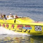 55-foot Super Cat side view yellow speed boat people inside